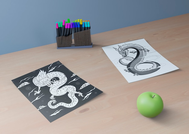 Monochrome snake sketch and apple beside