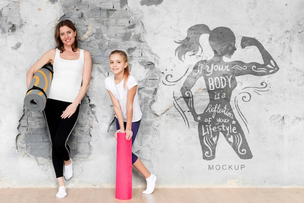 Mother and daughter doing sport mock-up