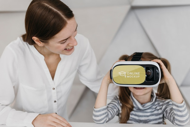 Mother and little girl with virtual reality headset