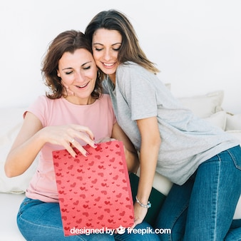 Mothers day mockup with daughter and mother looking into bag