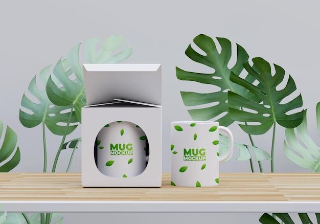 Макет кружки и коробки с дизайном листвы
