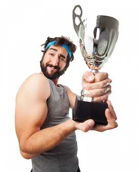 Muscular man with a trophy