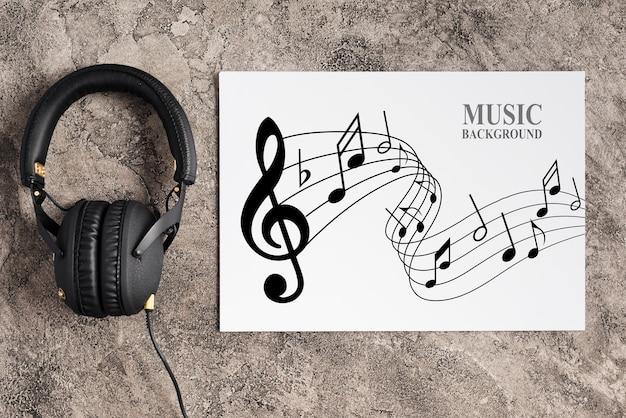 Music design on sheet with headphones beside