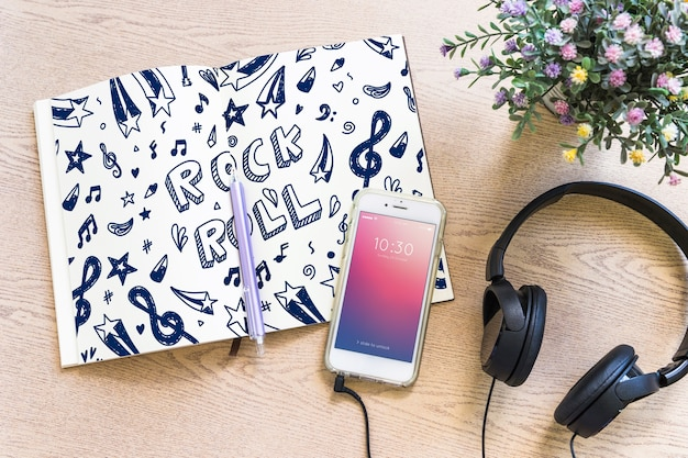 Music mockup with headphones and smartphone