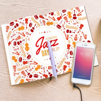 Music mockup with smartphone and brochure