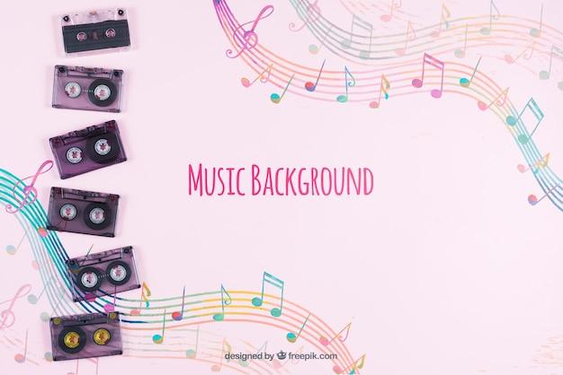 音楽的な背景を持つテーブルに配置された音楽テープ