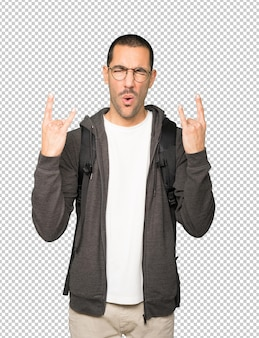 Naughty student making a rock gesture