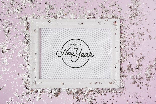 New year lettering on frame mock-up with confetti