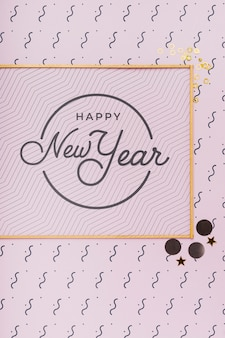 New year lettering on minimal golden frame