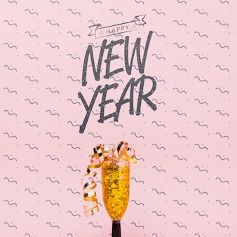 New year lettering with golden confetti