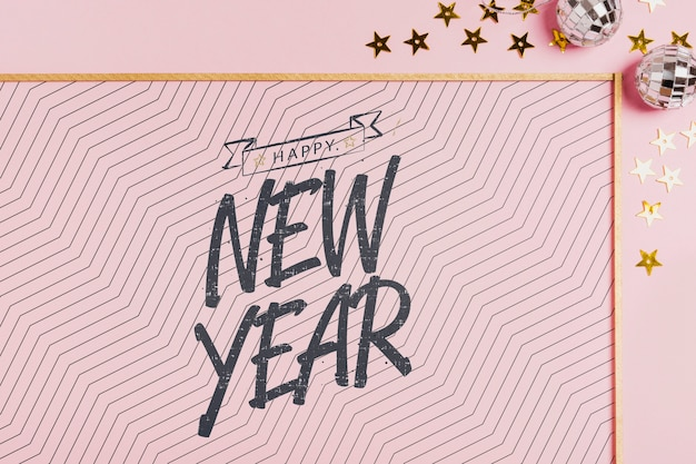 New year lettering with simple frame on pink background