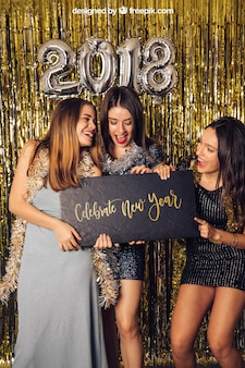New year mockup with three girls holding small board