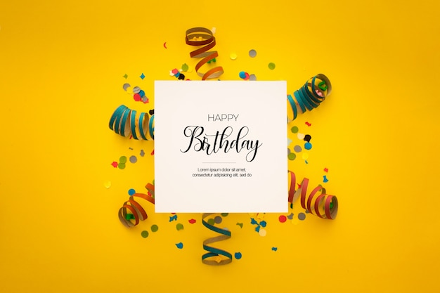 Nice birthday composition with confetti on yellow