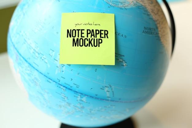 Note paper on globe mockup psd