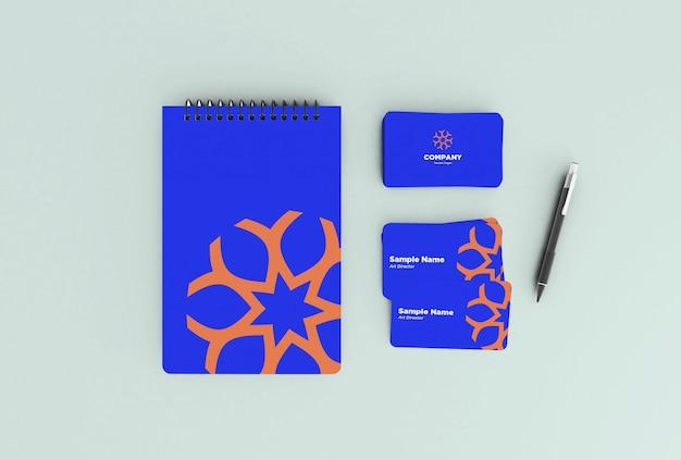 ノートブックと名刺のモックアップデザイン