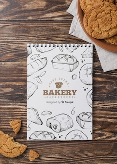 Notebook and biscuits on table