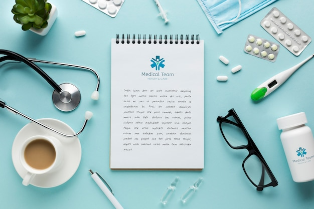 Notebook on medical desk with cup of coffee