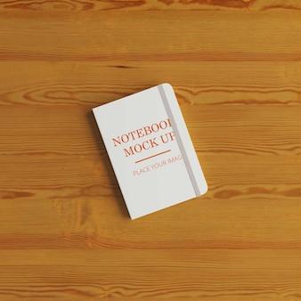 床にモックアップされたノートブック