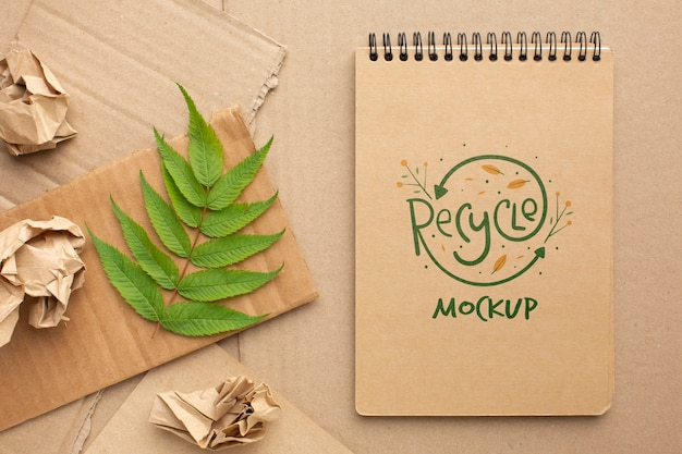 Notebook mock-up with leaves