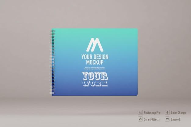 柔らかい色の背景に分離されたノートブックのモックアップ