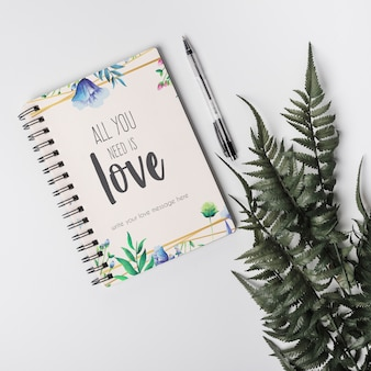 Notebook mockup next to leaves