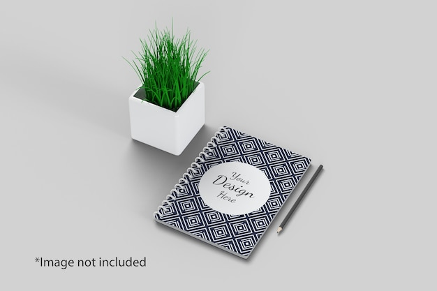 Notebook mockup right angle view with plant