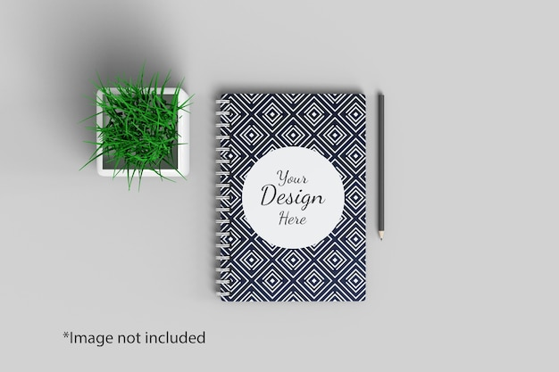Notebook mockup top angle view with plant