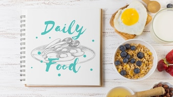 Notebook mockup with breakfast concept