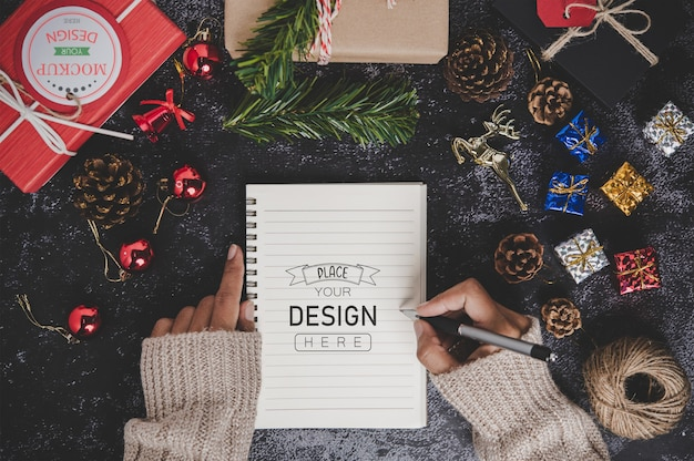 Notebook mockup with christmas decoration
