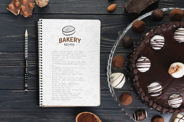 Notebook mockup with delicious pastry