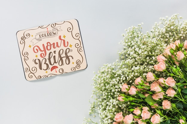 Notebook mockup with floral decoration for wedding or quote