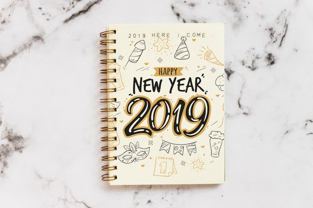 Notebook mockup with new year concept