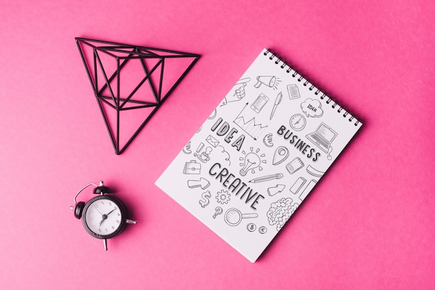 Notebook mockup with pyramid