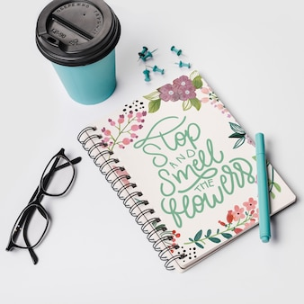 Notebook mockup with take away coffee cup