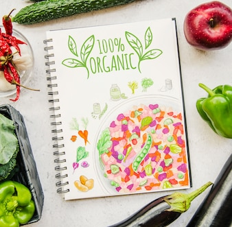 Notebook mockup with vegan food