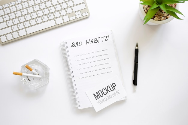 Notebook with bad habit list on office