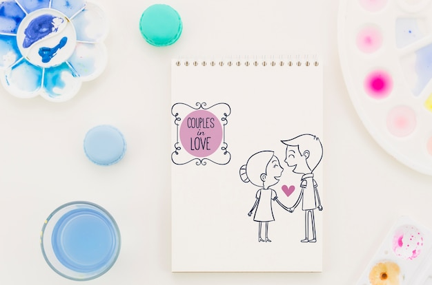 Notebook with couple in love drawing