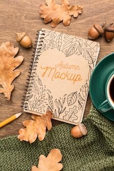 Блокнот с чашкой кофе макет