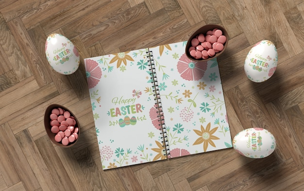 Notebook with easter eggs on table