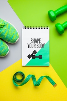 Notebook with fitness shoes and weights