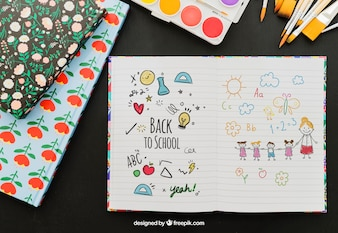 Notebook with hand drawings and school materials