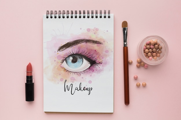 Notebook with makeup for eyes concept