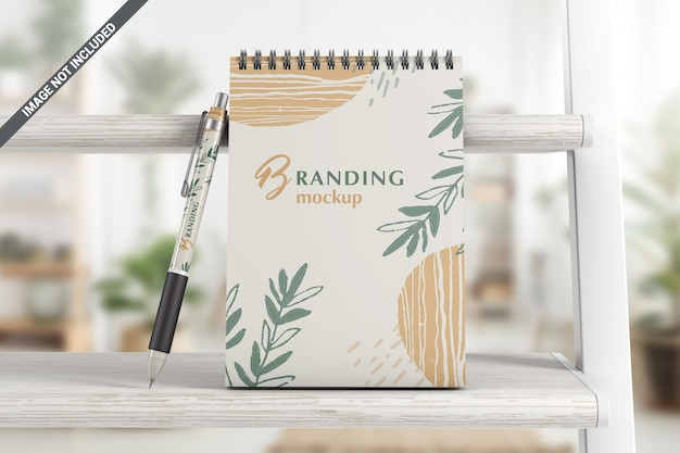 Notebook with pen branding mockup