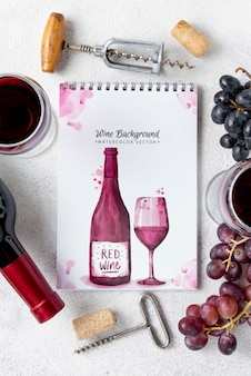 Notebook with wine bottle on table