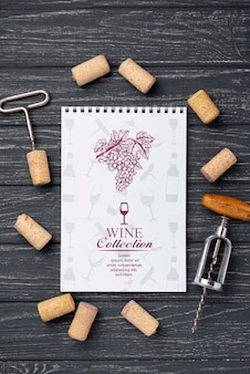 Notebook with wine stoppers on table
