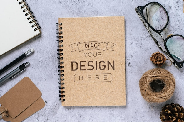 Notebook with work space psd mockup