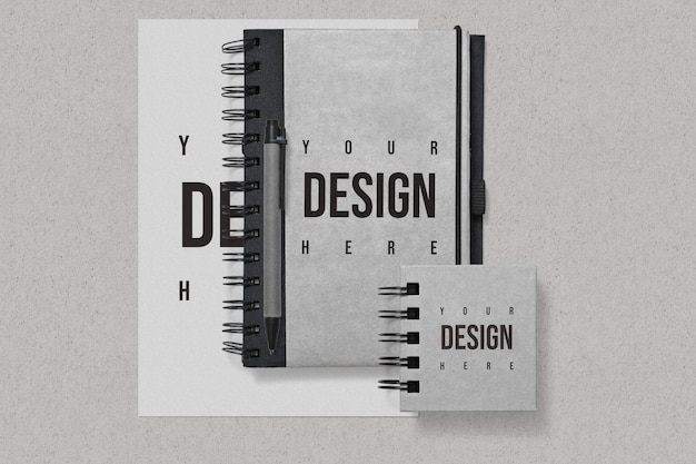 Notebooks and paper mockup on grey background