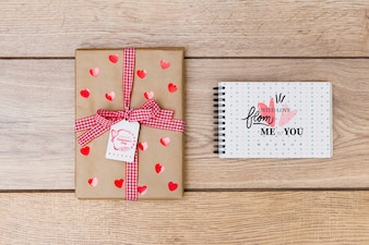 Notepad mockup next to gift box for valentine