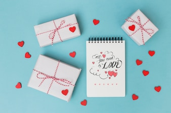 Notepad mockup next to gift boxes for valentine