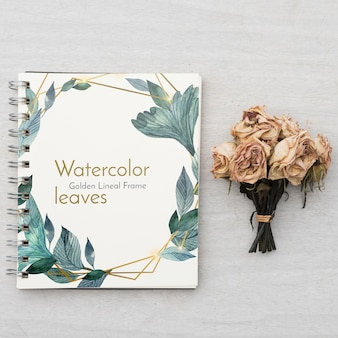Notepad mockup with floral concept